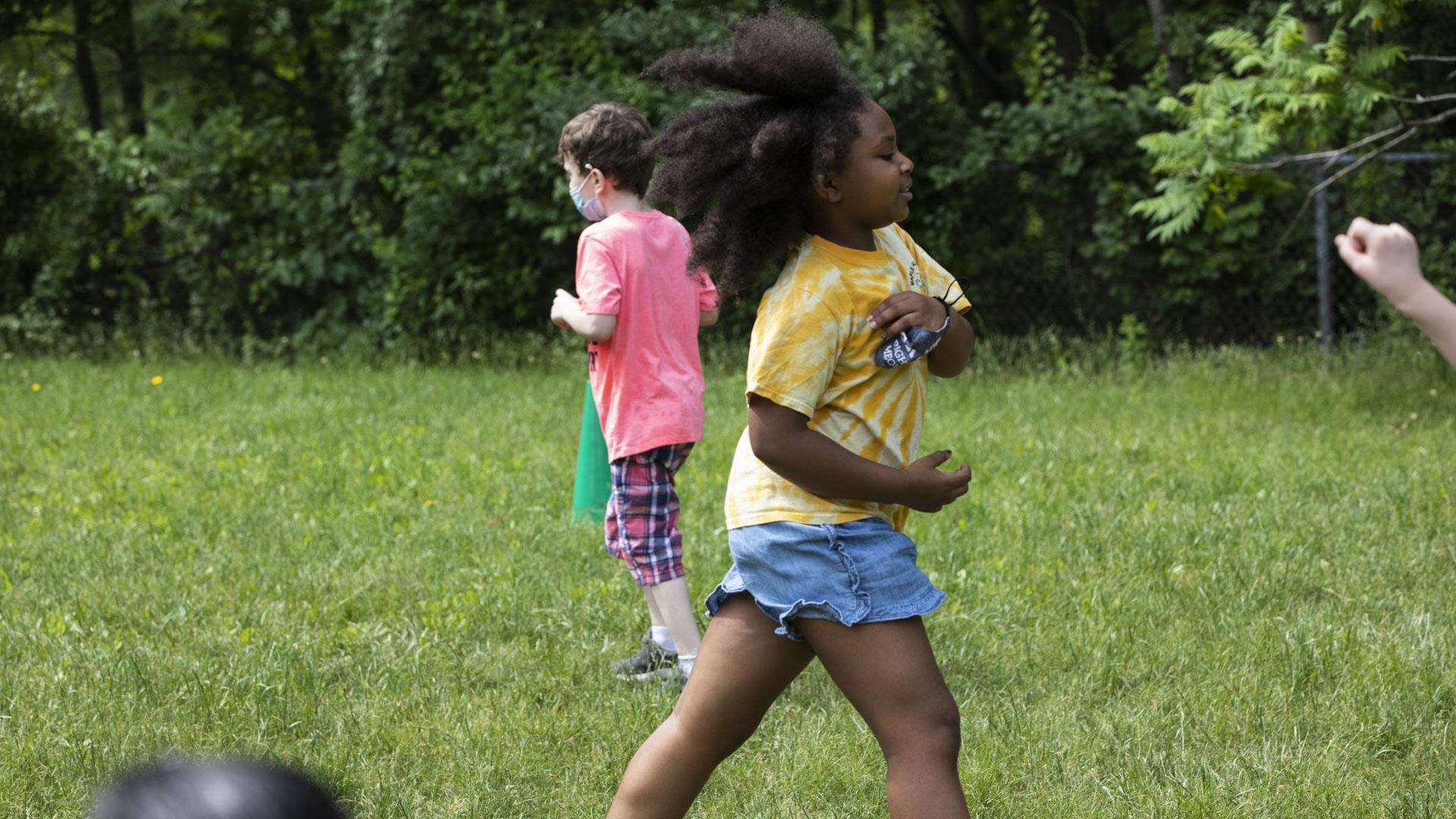 Student running in grass