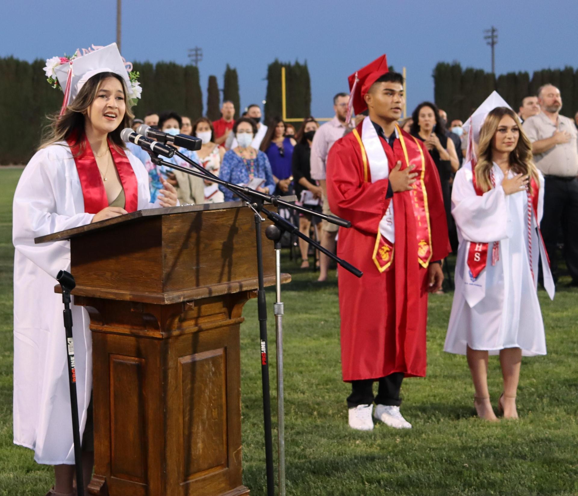 Milliana Montez singing the National Anthem