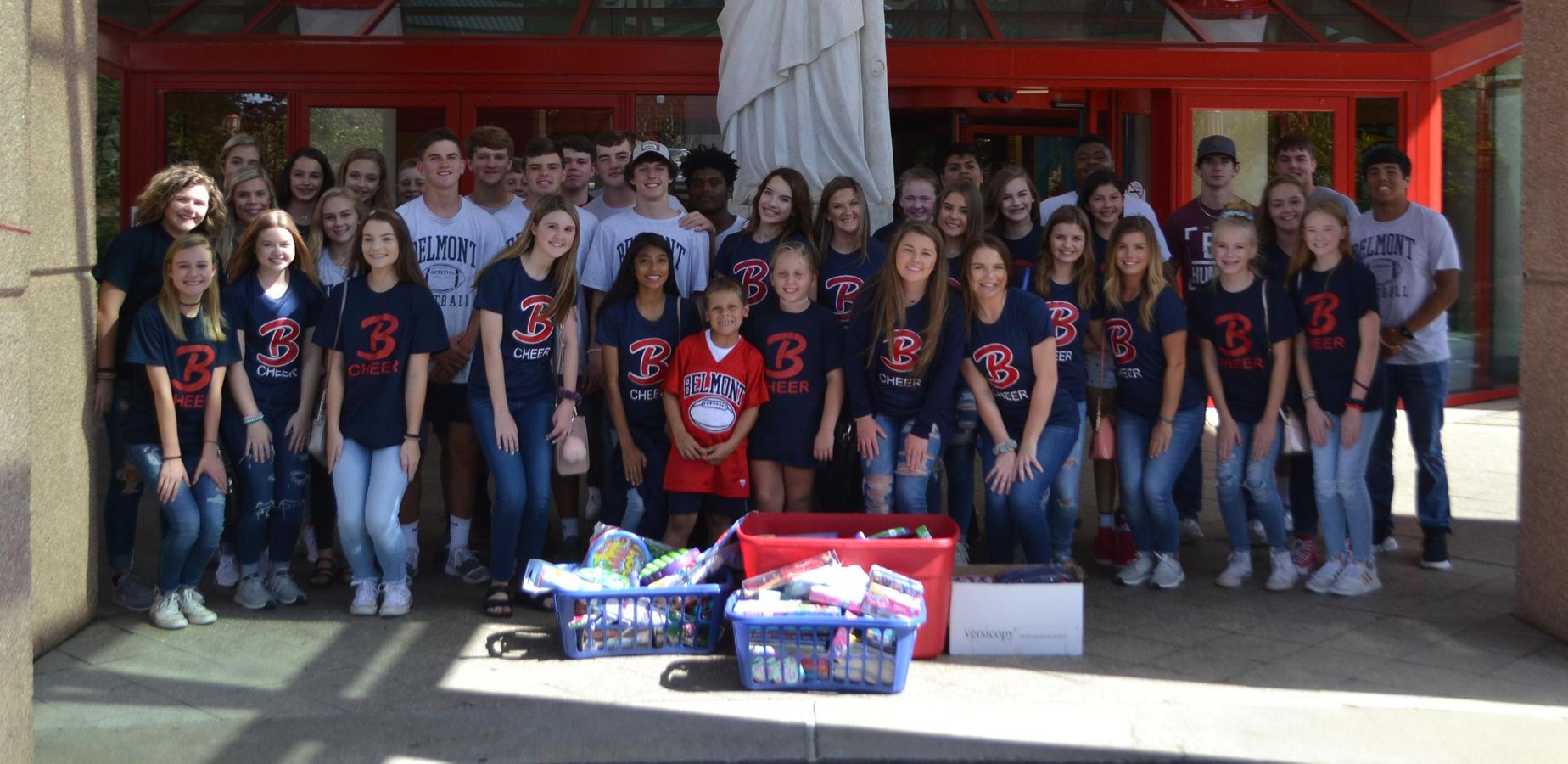 Belmont Football and Cheer deliver toys to St. Jude