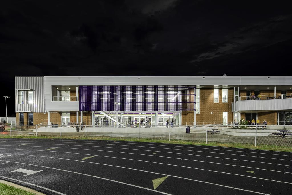 view of the school from the track at night
