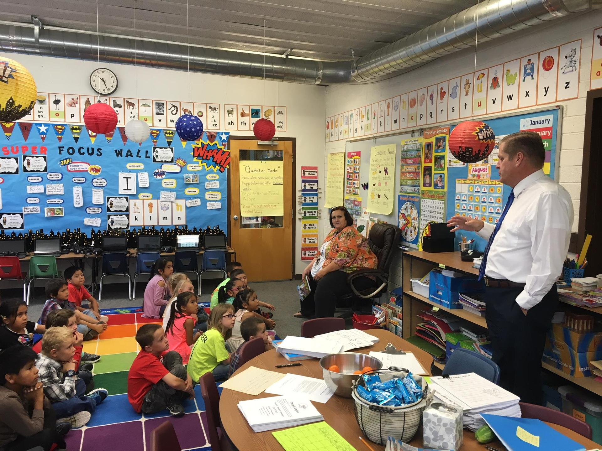 Superintendent talking with students