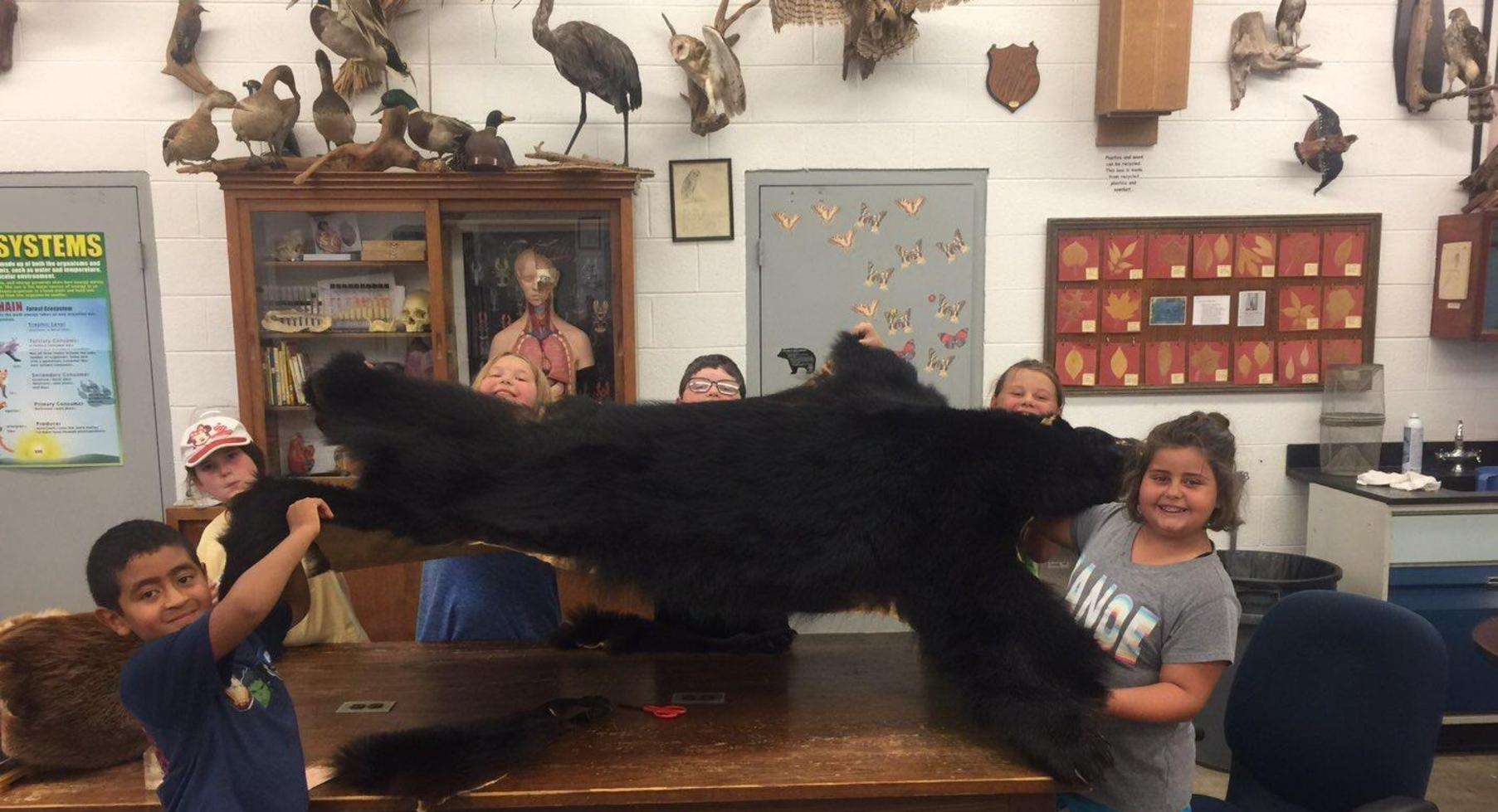 Students with bear skin.