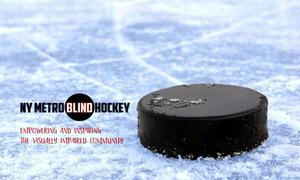 Image of a hockey puck on a skating rink with the logo of the NY Metro Blind Hockey. Words: Empowering and inspiring the visually impaired community.