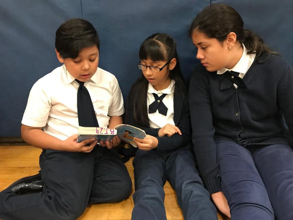 Students share a chapter book