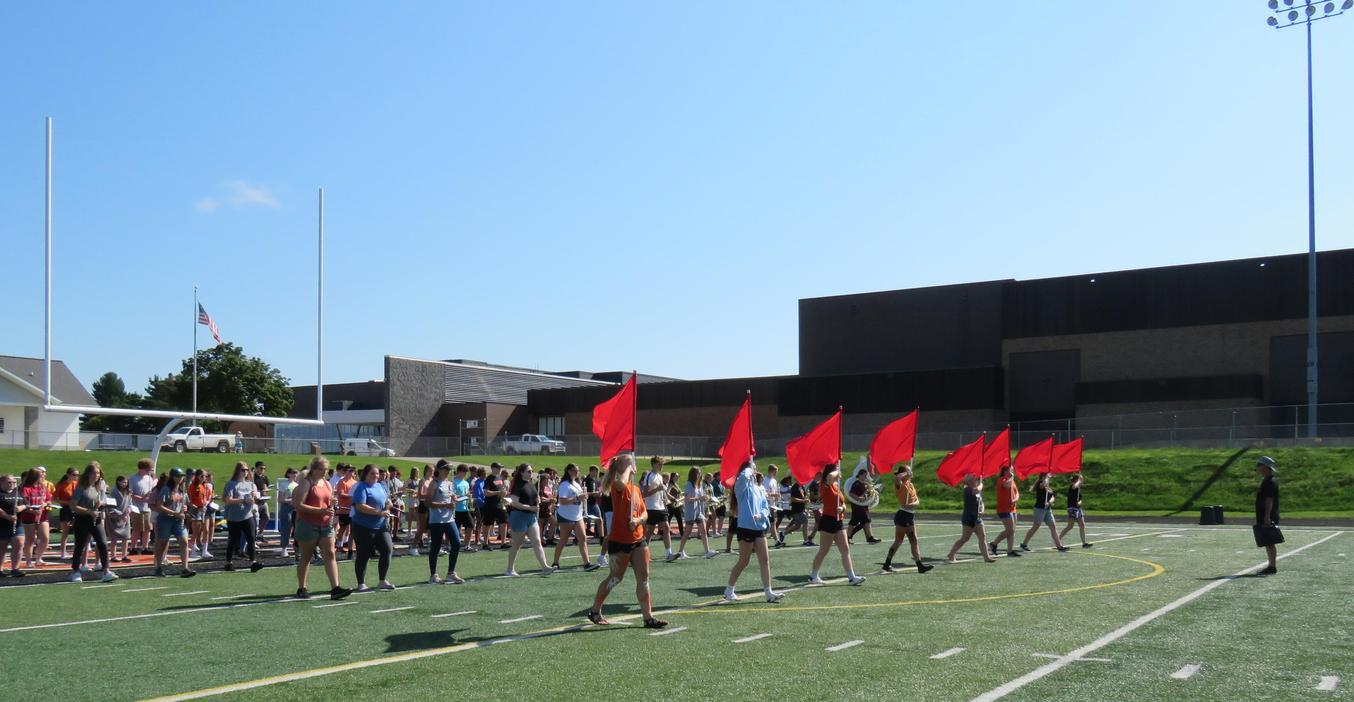 TKHS marching band steps onto the field during band camp.