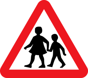 School kids crossing street sign