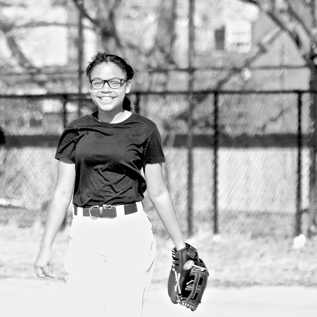 Softball team player posing.