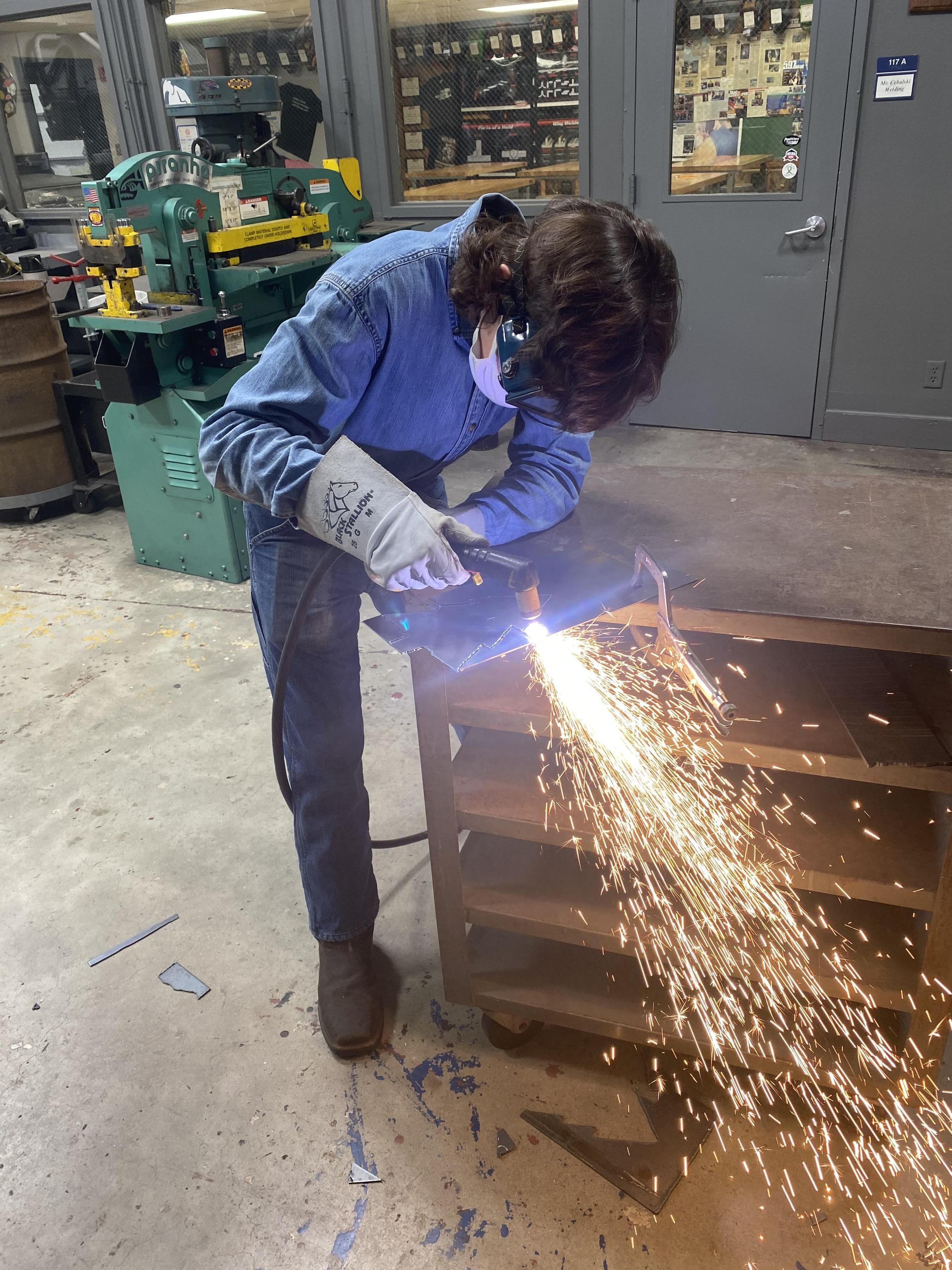 Student plasma cutting.