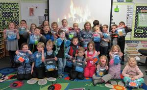 McFall Elementary students got a special birthday treat from a classmate whose mother made them each a pair of mittens.