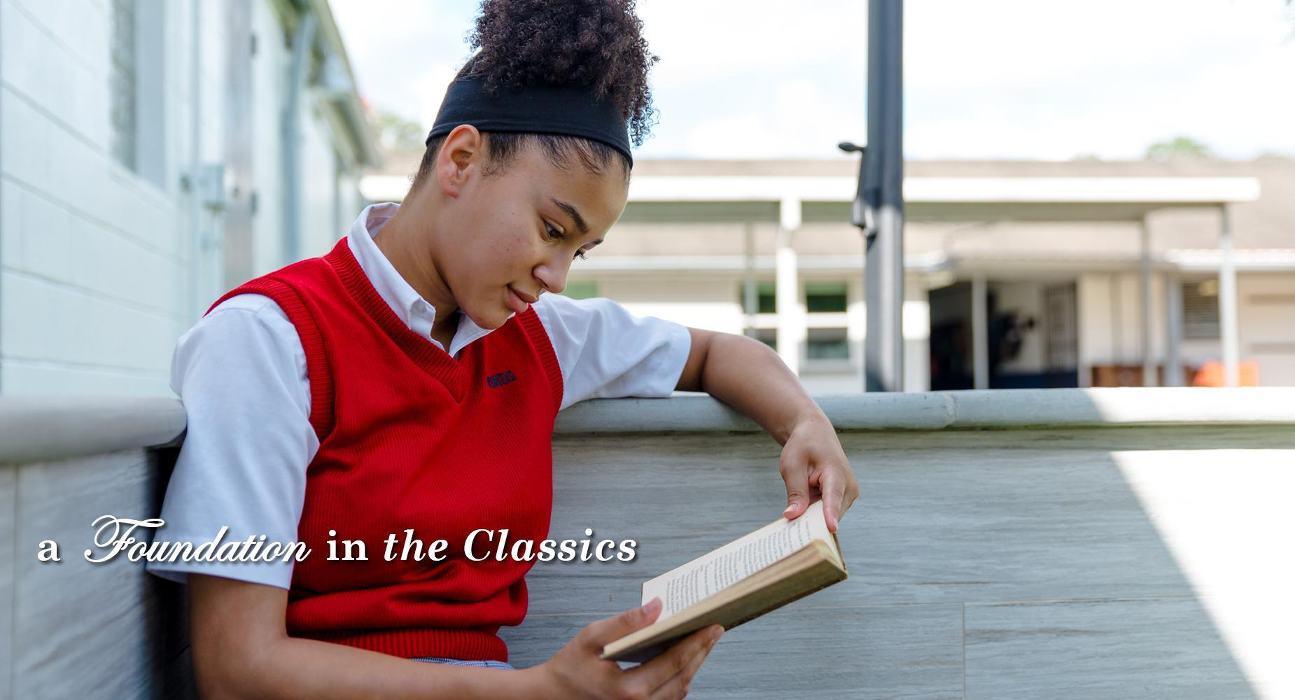 a foundation in the classics with a student reading