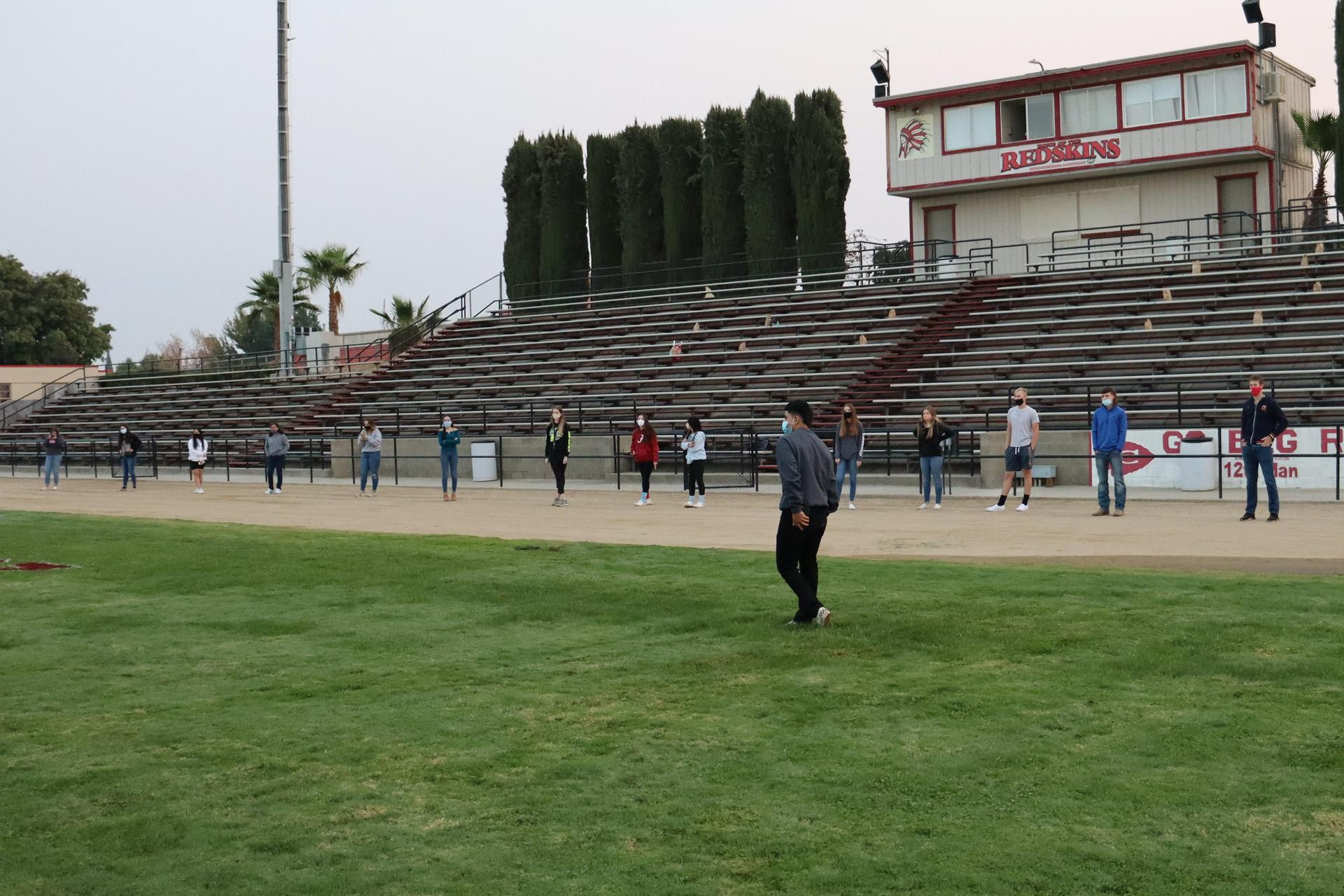 seniors on sidelines at the end of senior sunrise