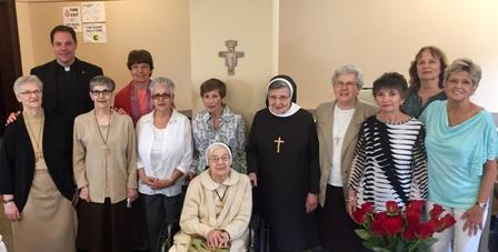 Members of the OLSH Class of 1962 pose together after attending Mass in the OLSH Chapel