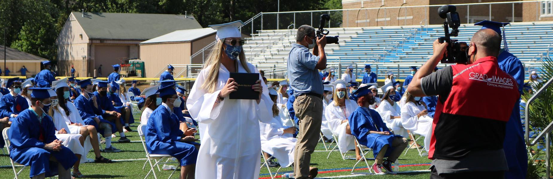 Photo of WHS graduate posing for picture.