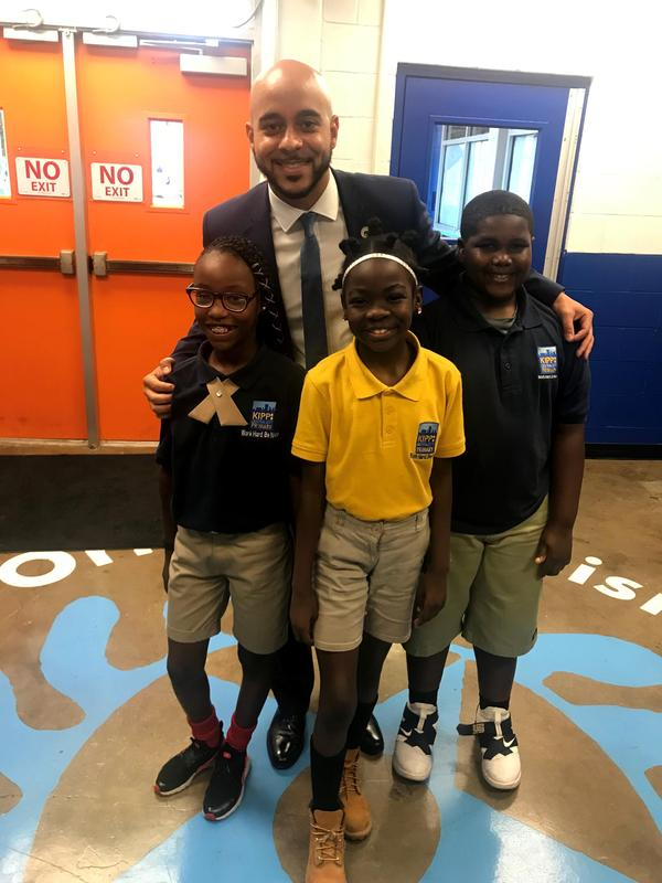 Royce Duplessis poses with KCCP students