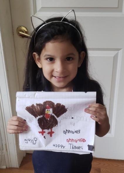 Student holding her turkey drawing