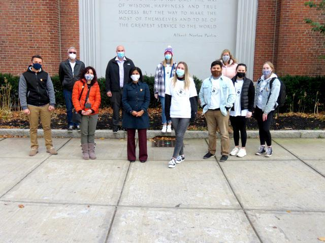 Group photo, outside, in front of the Parlin School
