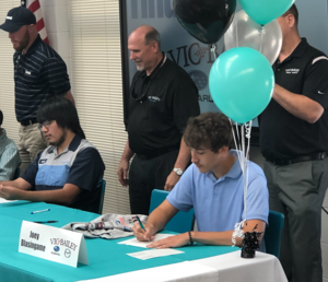 A Dorman male student signs a letter of intent with a local company