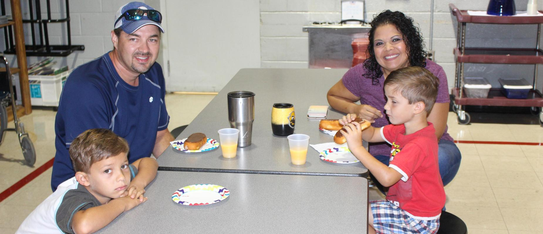 parents eating donuts with students