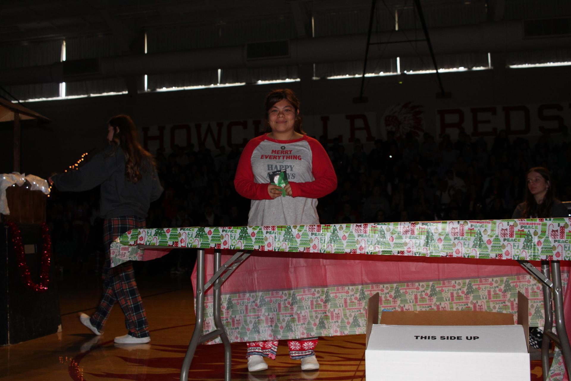 Noeila Hernandez  opening her gift