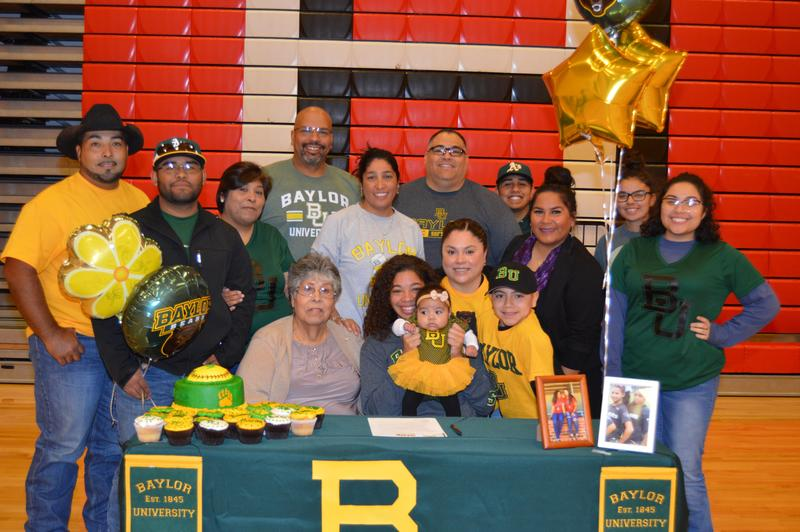 student and family on signing day