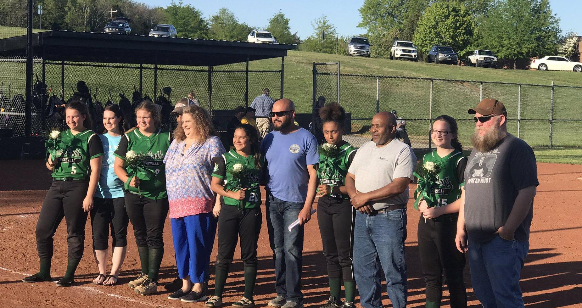 A picture of 8th grade softball players with parents