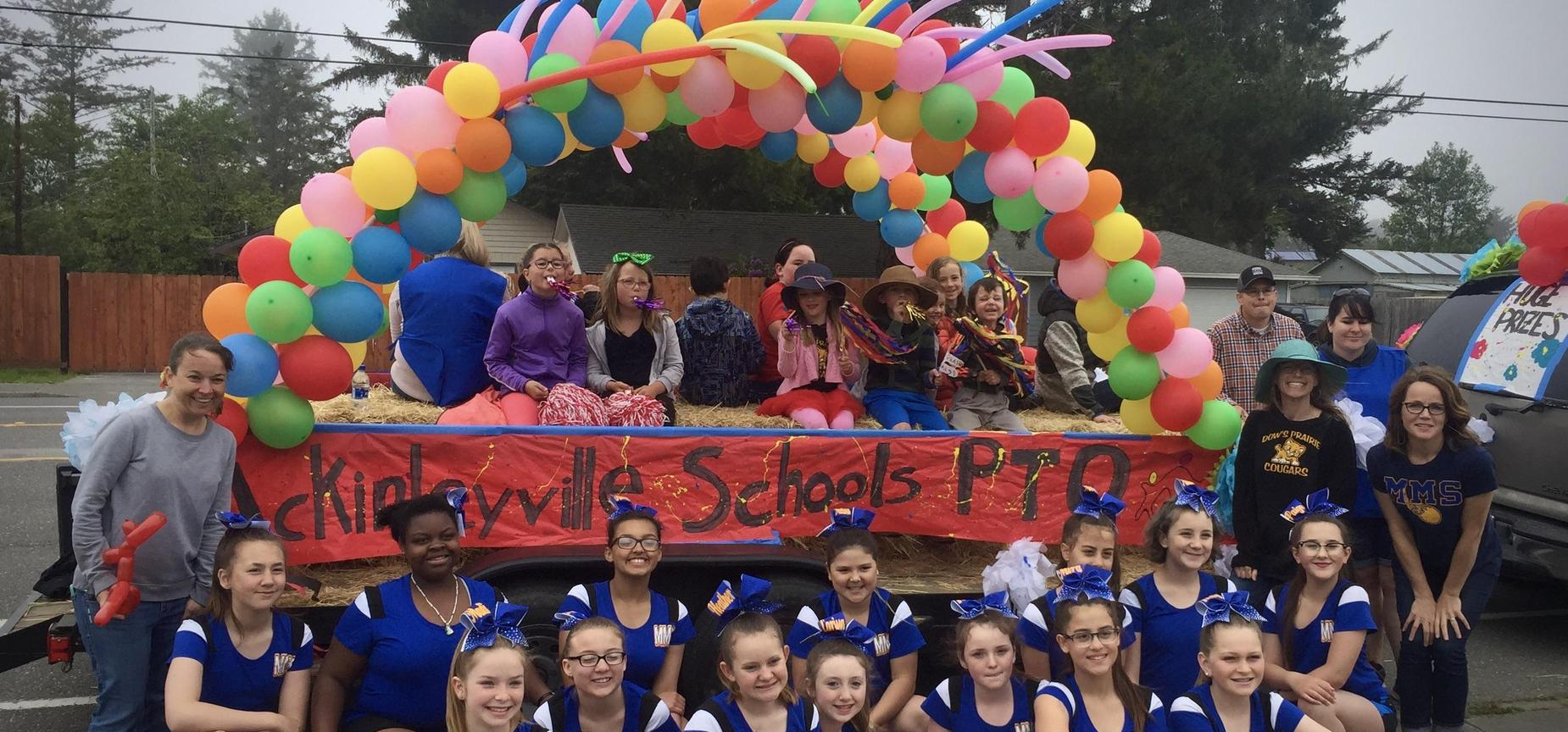 district students and volunteers on a parade float