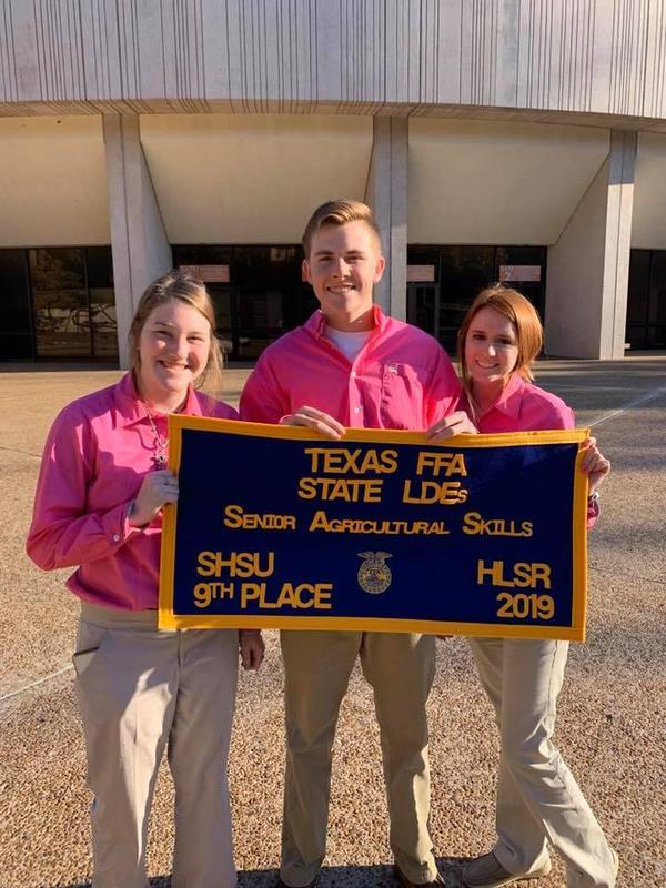 3 students pose with FFA banner indicating 9th place in Senior Ag Skills place in