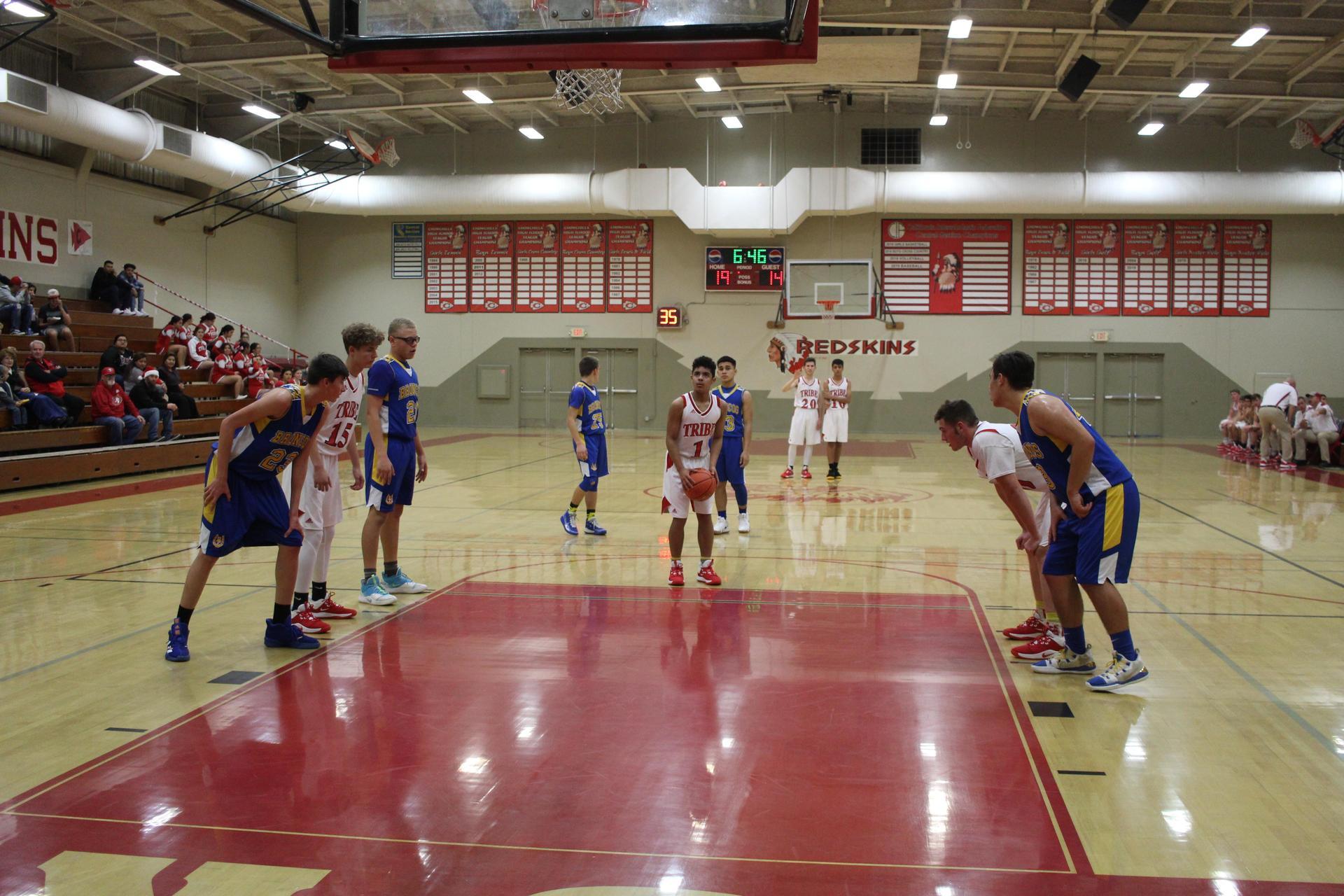 J v boys playing basketball against dos palos