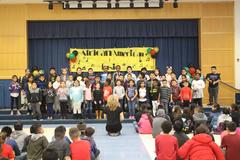 Second grade performing for African American