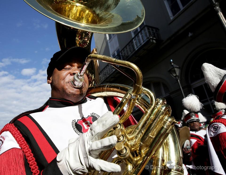 Photo of Baker High School player on Tuba at the Krewe of Cork Parade in New Orleans
