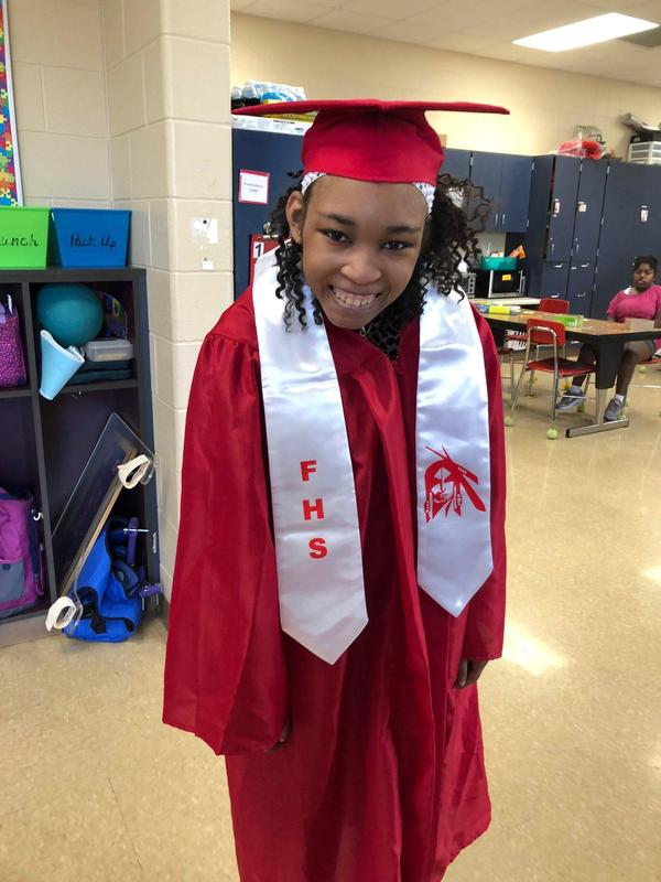 Photo of Franquie Johnson, the Fairfield High School Student who passed away recently. She is wearing her cap and gown in the photo
