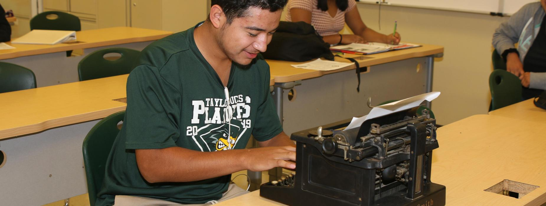 Student using a typewriter.