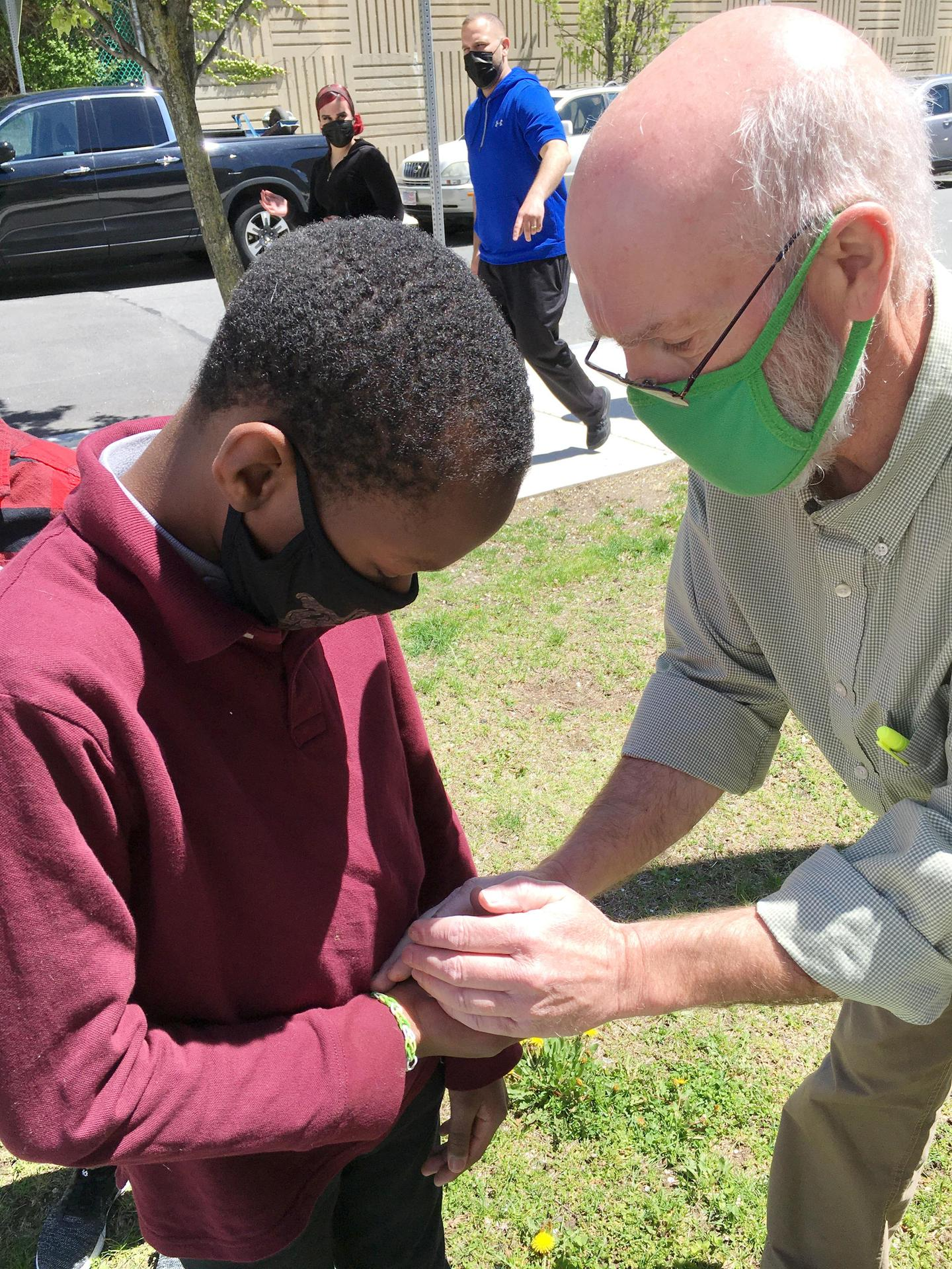 Student and teacher getting ready to release a butterfly