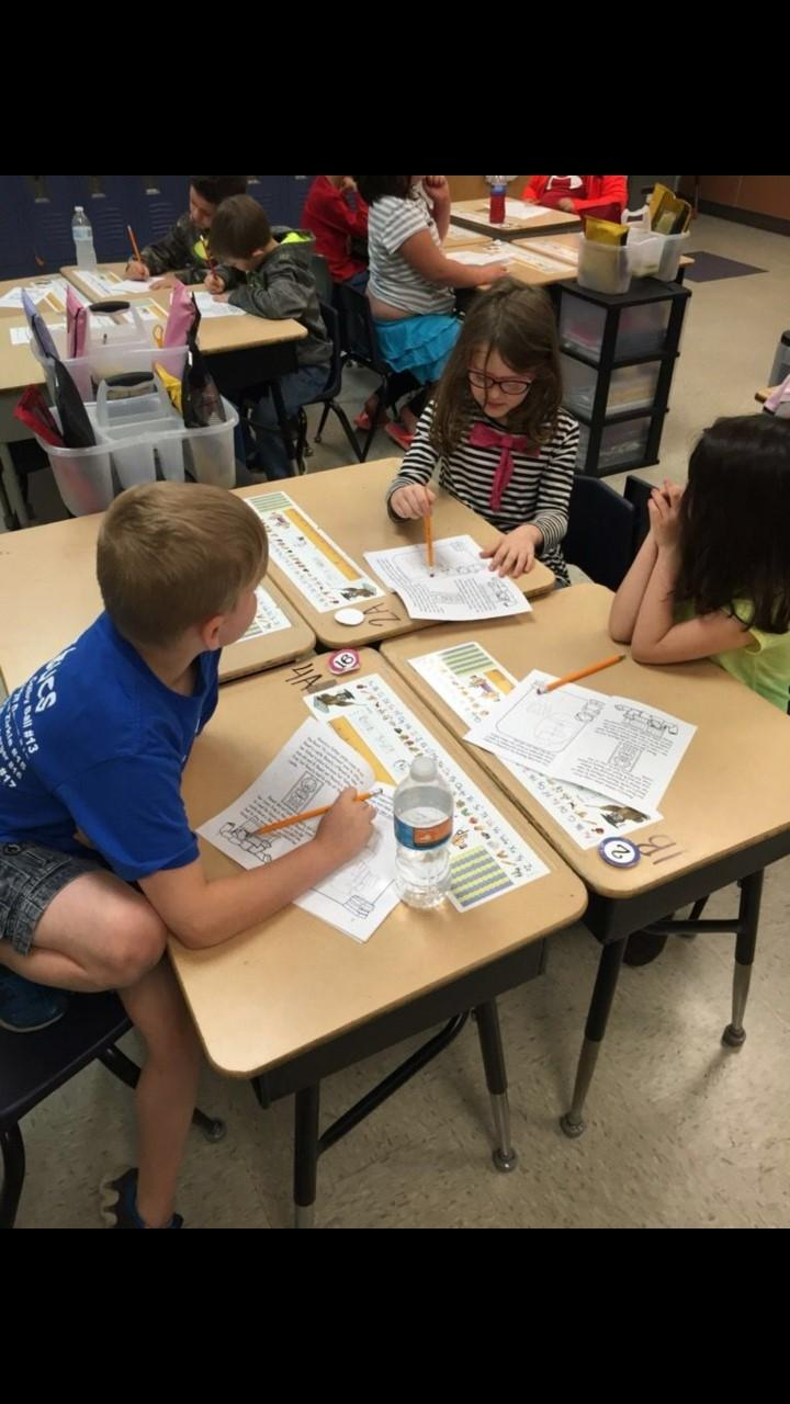 Students collaborate while working on a 1st grade STEM project.