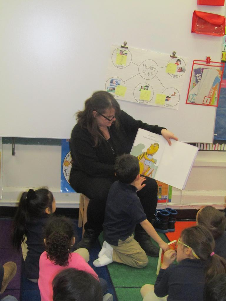 teacher reading to class a dr. seuss book