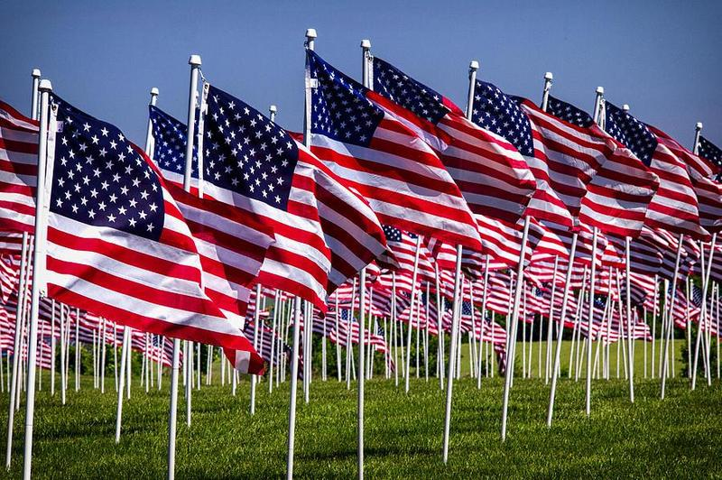 """Dear Friend and Supporter:  Our 15th annual """"Field of Flags"""" will be on display November 1st to November 30th at  Businesses, cities, colleges, and schools throughout Tipton County.  Please join the Exchange Club of Tipton County and the Carl Perkins Center in promoting patriotism while also helping our efforts to prevent child abuse in our community.     The """"Field of Flags"""" event is a magnificent display of American flags with each flag representing the life of a hero.  Flags can be dedicated in the honor of, or the memory of, those who service our community or country. Military veterans who have served, or are serving in the armed forces, or public servants such as firefighters, law enforcement officers, and emergency medical, or your own personal hero can be recognized."""