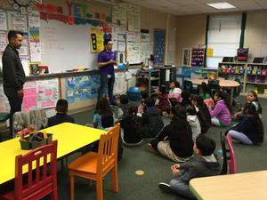 Kaiser employees present workshop to third graders on stop light conflict resolution model