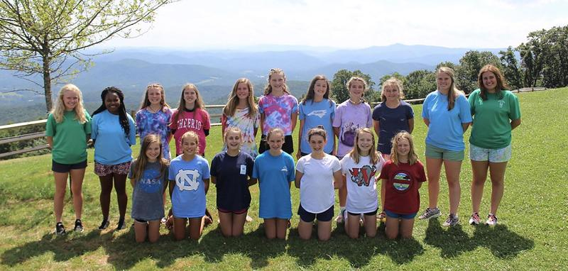 Junior Stella Cole (far right) with her group at Camp Cheerio