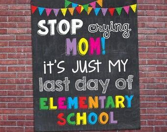 sign that states -wording - in color stop crying mom it's just my last day of Elementary school