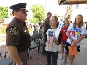 TKMS students shake hands with Barry County Sheriff.