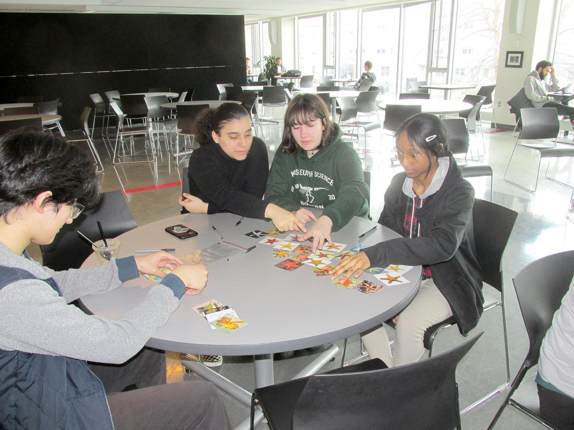 Students work on a project at a round table