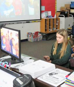 Students ask questions via Skype with other fifth-graders in Minnesota.
