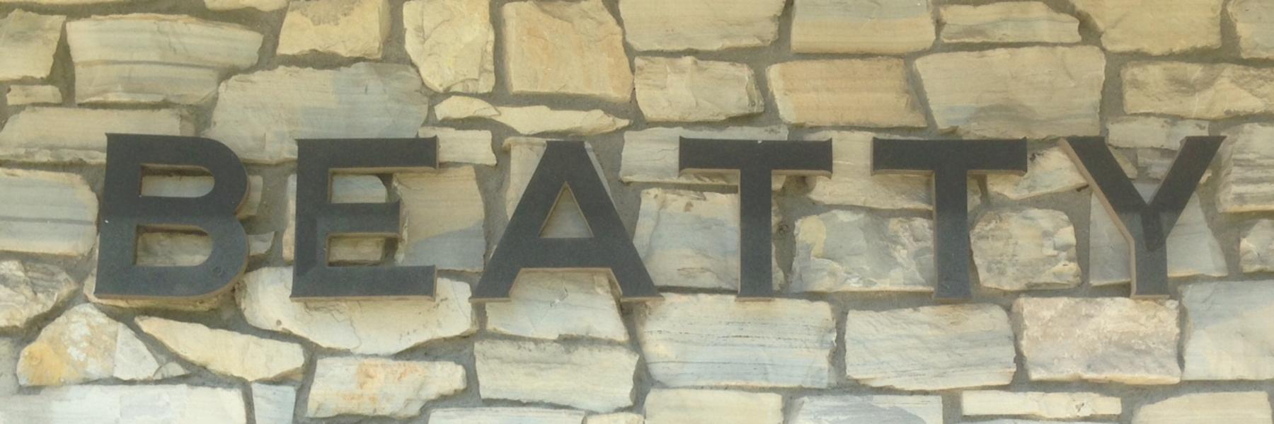 Image of the original Beatty metal signage