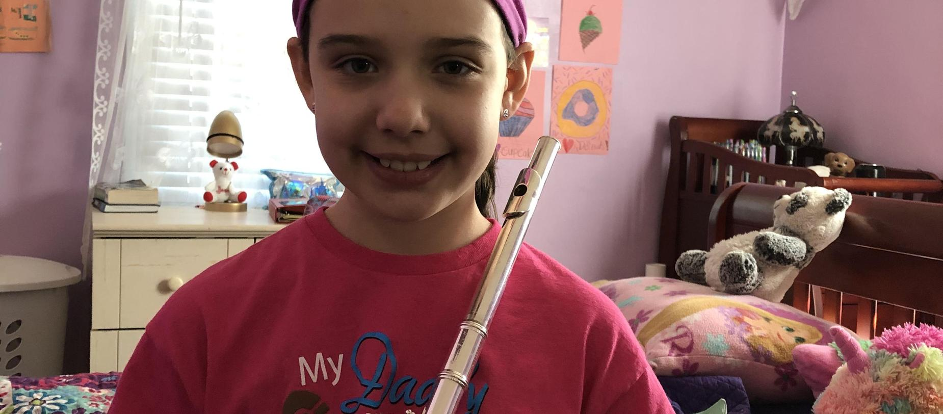 student with her flute