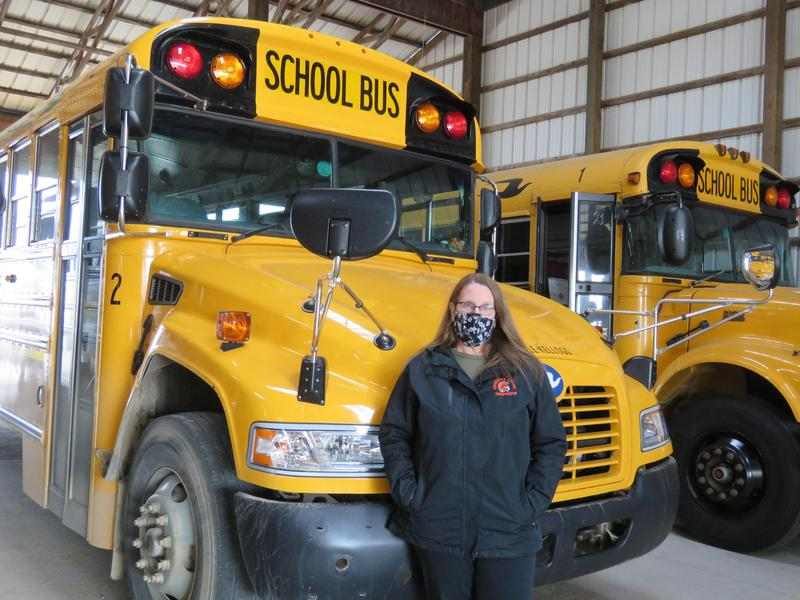 TK Bus Driver Sue Mugridge stands beside her TK Bus #2.