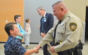Brody shaking hands with Deputy Medina