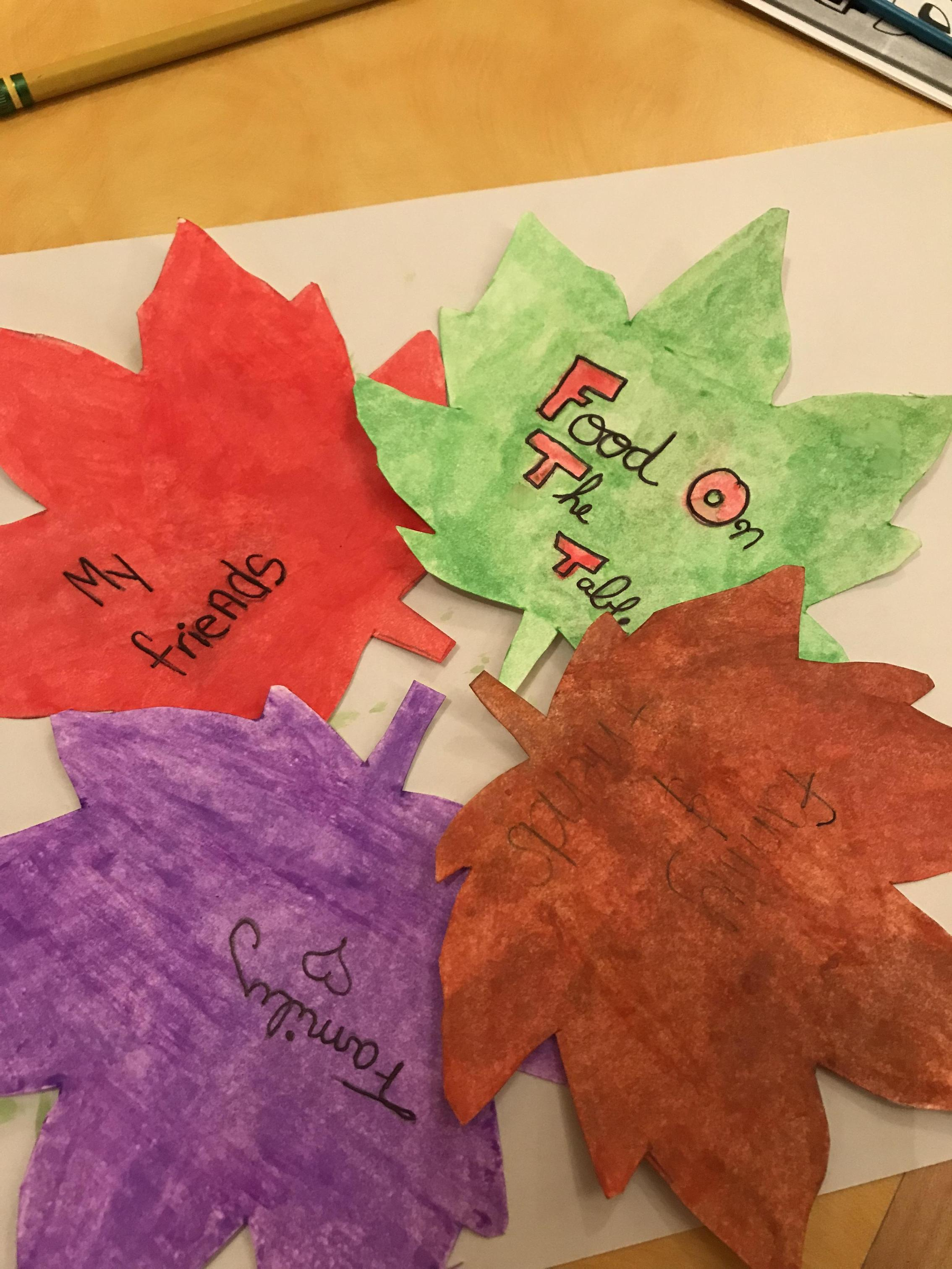 four painted leaves red green purple and brown