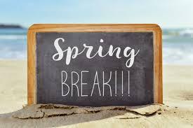 a blackboard in the sand with the words spring break written in chalk