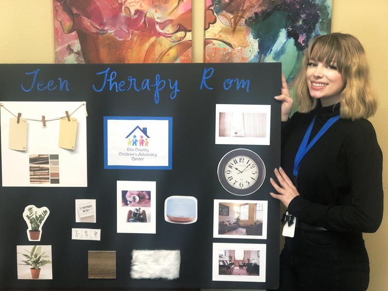 young lady poses with Teen Therapy Room vision board