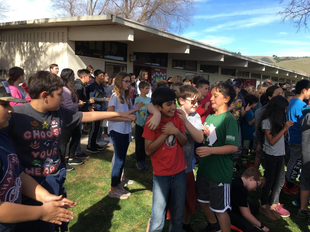 kids being silly at assembly